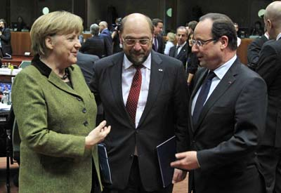 Germany's Chancellor Merkel, European Parliament President Schulz and France's President Hollande attend a meeting to discuss long-term budget in Brussels